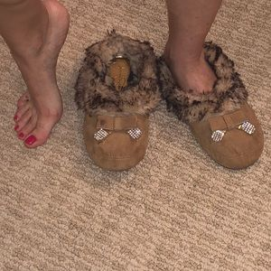 Well worn slippers. Used slippers.